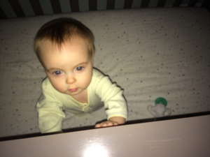 Baby-Awake-Red-Eyes-in-Crib
