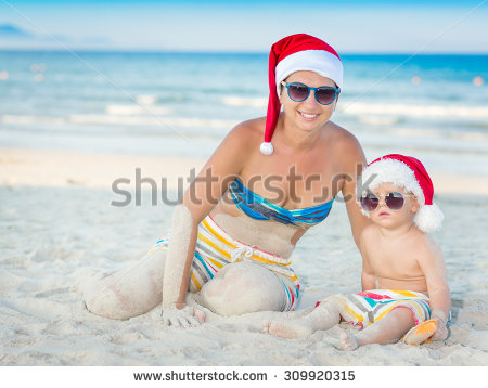 stock-photo-baby-and-mother-on-the-beach-christmas-concept-309920315